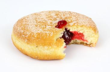 Fresh raspberry filled donut that has been bitten