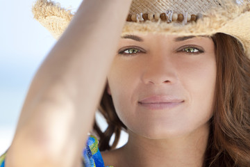 Outdoor Portrait of Woman With Green Eyes Wearing Cowboy Hat