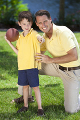 Father Teaching His Son To Play American Football