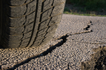 Tire And Cracked Asphalt