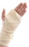 Bandaged woman hand isolated on white background