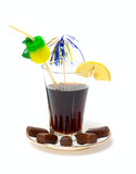 Glass with drink and chocolate candy