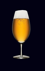 Glass of beer isolated on a black background