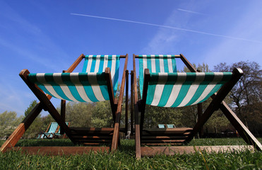 Deckchairs in Hyde Park, London in summer