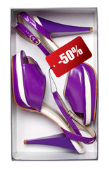 Female violet shoes with price tag in box. With path