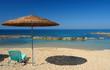 Leinwandbild Motiv Plage de Méditerranée, ;parasol et chaise longue