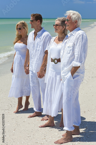 Two Generations of Family Holding Hands on a Tropical Beach