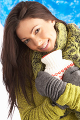 Young Woman Wearing Warm Winter Clothes Holding Hot Water Bottle