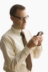Businessman Texting on a Cell Phone - Isolated