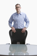 Businessman Standing at a Conference Table - Isolated