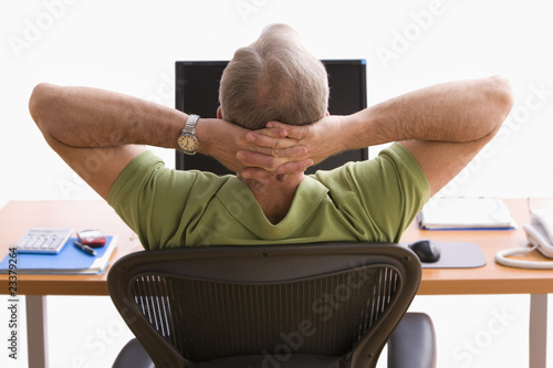 Man Relaxing at His Desk