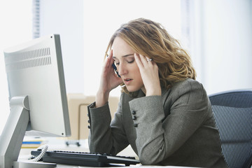 Stressed Businesswoman Working in Office