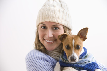 Attractive Young Woman and Dog Wearing Sweaters