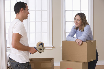 Attractive Young Couple Packing And Smiling
