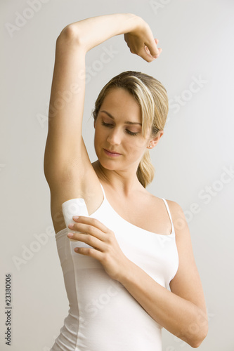 Woman Applying Deodorant