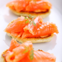 delicious appetizer with salmon pancakes