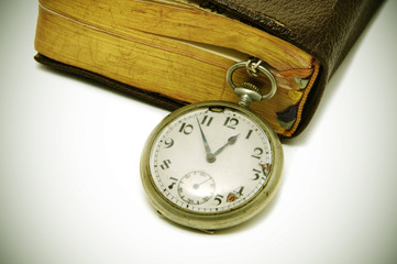 ancient book and pocket watch