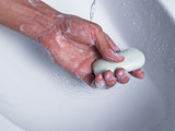 Holding soap one hand
