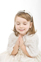 Beautiful little girl praying