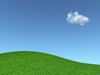 grassy hill and blue sky with a cloud