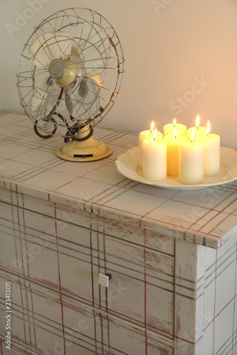 candles on a chest of drawer
