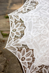 part of hand made white lacy umbrella