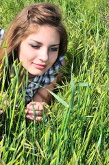 sweet tender girl in grass
