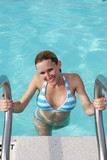 Attractive Thirtysomething Woman at the Pool in Bikini