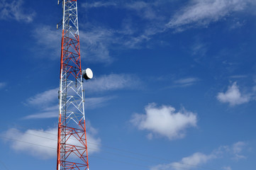 radio antenna tower against blue sky