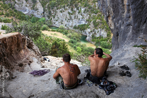 Two rock climbers having a rest