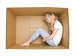 Woman in a cardboard box