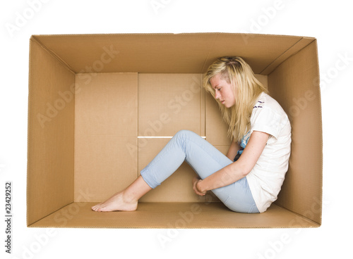 Woman in a cardboard box