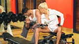 Sporty couple are exercising at gym centre