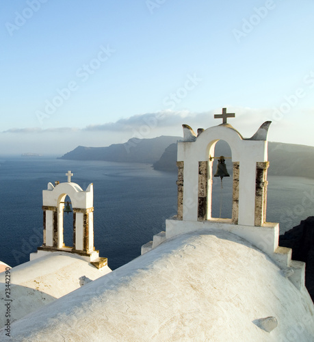 greek island twin bell tower church over the caldera oia santori