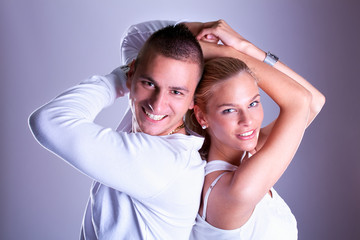 Happy Young loving couple hugging