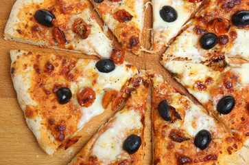 Pizza with Mozzarella, Olives and Cherry Tomatoes
