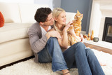 Couple Taking Playing With Pet Cat At Home - Fine Art prints