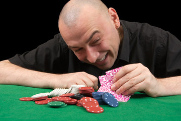 man in black shirt playing in casino poker