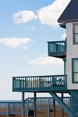 House with balcony near the ocean