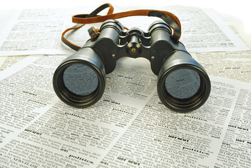 black binoculars and news
