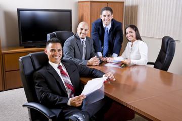 Hispanic business people meeting in boardroom
