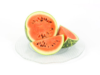 Small baby watermelon cut on a large glass platter