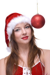 Closeup portrait of girl in santa dress and christmas balls