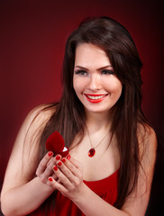 Girl with jewellery box on red background.
