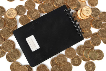 notebook and coins