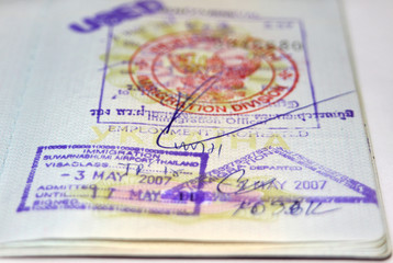 Passport with Thailand visa and stamps