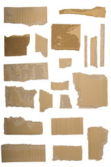 Pieces of torn brown corrugated cardboard, Isolated on White