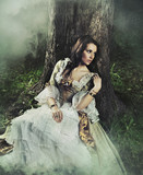 Fototapety Gorgeous brunette beauty in a old-fashioned dress in a forest