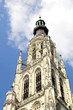 Breda Cathedral tower against a blue sky