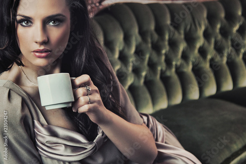 Portrait of a beautiful lady drinking afternoon coffee
